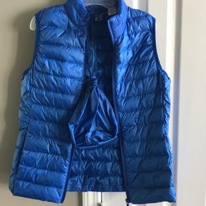 Blue down vest that packs into its small bag